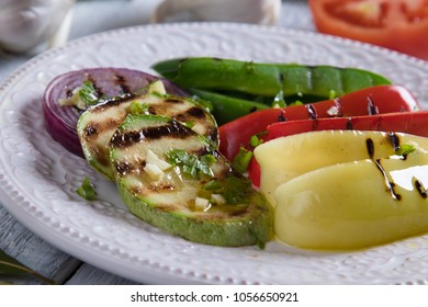 Grilled red,green and yellow peppers and other vegetables