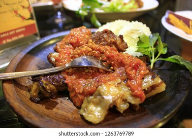 Grilled ribs with chili sauce, rice and vegetables