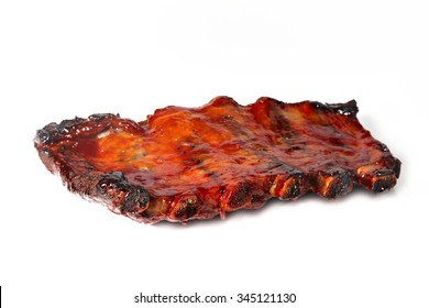 Grilled ribs isolated on white, shallow focus
