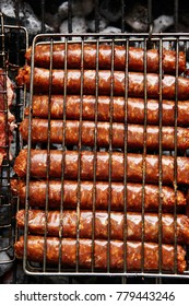 grilled roast beef lamb sausages on bbq grid over charcoal