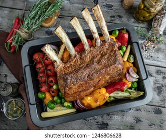 Grilled roasted rack of lamb,veal with vegetables on the baking sheet