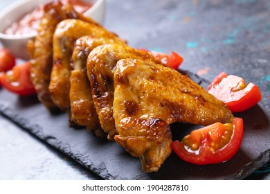 Grilled or roasted spicy chicken wings with bbq sauce
