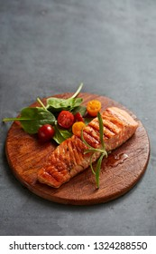Grilled salmon with baby greens and cherry tomatoes