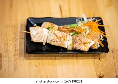 Grilled Salmon belly with Salt and black pepper on Wooden table background, Japanese food