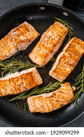Grilled Salmon Fillet Steak in a pan. Black background. Top view.