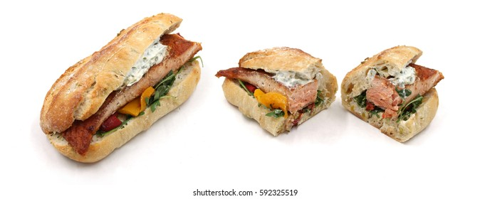 Grilled Salmon Fish Ciabatta baguette - Bun with vegetables and remoulade, tartar sauce - Snack, fingerfood, seafood sandwich, european, german - Isolated, white background