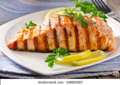 Grilled Salmon with lemon and  herb. Selective focus