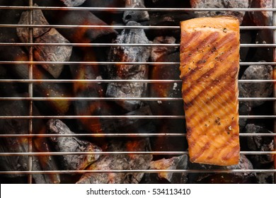 Grilled salmon with lemon on the flaming. Copy space for your text.