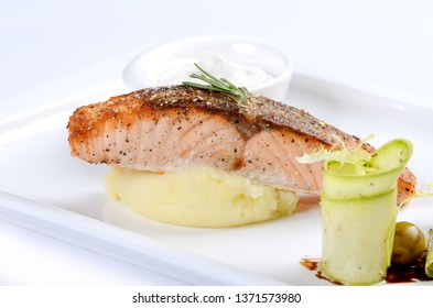 grilled salmon and mashed potatoes on the plate
