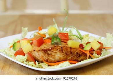 Grilled salmon with napa cabbage, carrot, tomato, and pineapple