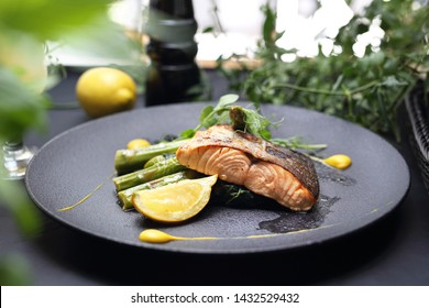 Grilled salmon on green asparagus. An elegant exquisite dish.