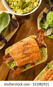 Grilled Salmon Sandwich with Bacon and Guacamole on Bread