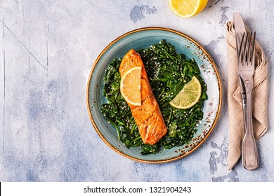Grilled salmon with spinach, top view.