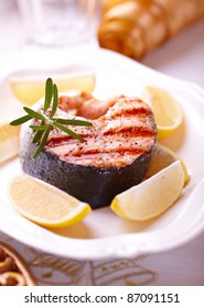 Grilled salmon steak with lemons for Christmas