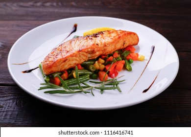 Grilled salmon steak with vegetable garnishing, tasty and delicious meals, dietary food, keto diet concept
