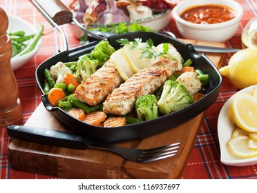Grilled salmon steak and vegetables in grilling pan