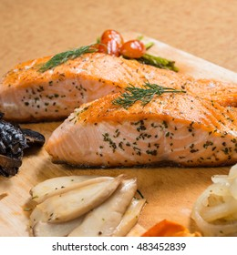 Grilled Salmon Steaks with Baked mix vegetables carrot onion portabello mushrooms oringi mushroom and tomato