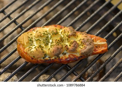 Grilled salmon steaks on the flaming.