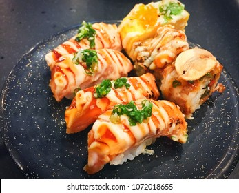 Grilled salmon sushi with mayonnaise