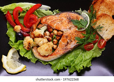 grilled salmon with vegetables herbs