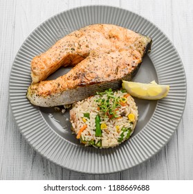 Grilled Salmon with Vegetables and Rice. On the table