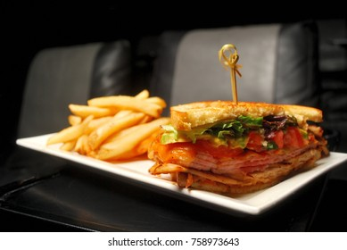 grilled sandwich and fries on white plate