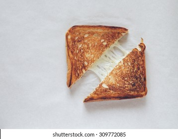 Grilled sandwich with melted cheese top view