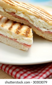 Grilled sandwich with melted feta cheese and ham