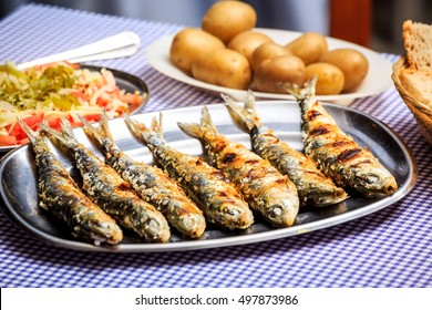 Grilled sardines with salad, bread and potato, Portugal