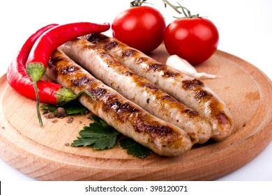 Grilled sausage with red hot pepper and tomatoes