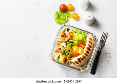 Grilled sausage and steamed vegetables, healthy meal prep bowl. Top view, space for text.