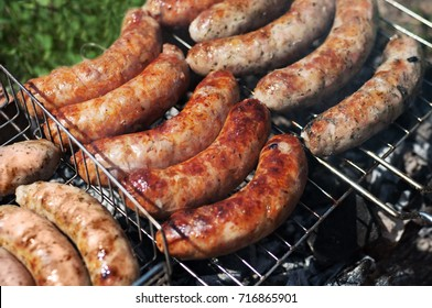 Grilled sausages. Closeup of sausage on the grill. Home-made Sausages. Bavarian sausages