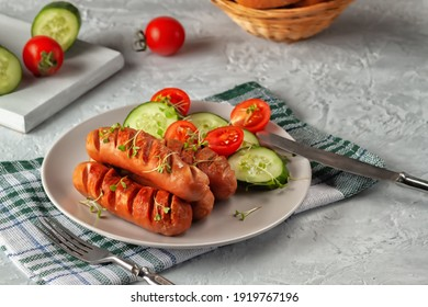 Grilled sausages with fresh vegetables are on the platter