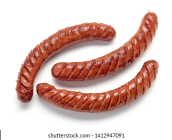 grilled sausages isolated on white background, top view