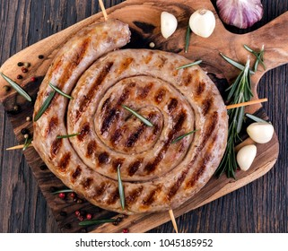 Grilled sausages on a wooden cutting board