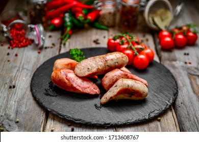 grilled sausages on a wooden table