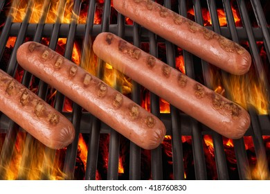 Grilled sausages over a hot barbecue grill.