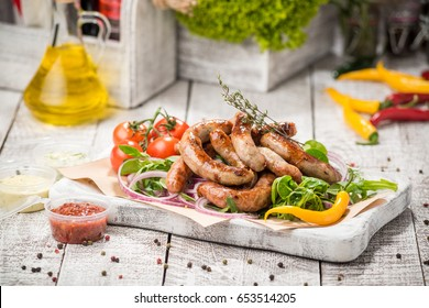 Grilled sausages and vegetables, On a paper plate