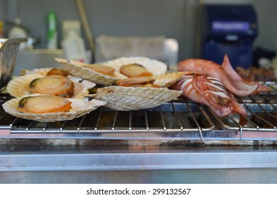 Grilled scallops and squids on a roaster in beer festival, Japan