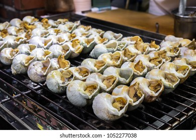 Grilled Sea Snail, local food served in Jiufen old street, Taiwan.