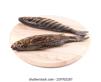 grilled seabass fish on platter. Isolated on a white background