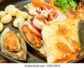Grilled seafood served with vegetables