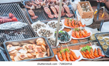 Grilled seafood with squid, shrimp, fish, crabs, shellfish and seafood sauce and spicy like people who like spicy food. The amphawa floating market, Samut Songkhram.Thailand.