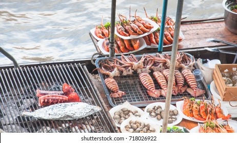 Grilled seafood with squid, shrimp, fish, crabs, shellfish and seafood sauce and spicy like people who like spicy food. The  amphawa floating market, Samut Songkhram Thailand.