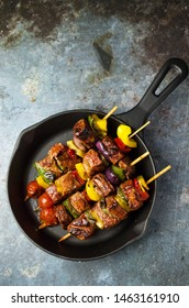 Grilled Shashlik with vegetables on frying pan