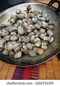 Grilled shell seafood or known as kerang, served in frying pan