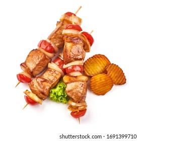 Grilled Shish kebab. Skewers with pieces of roasted barbecue, isolated on white background.