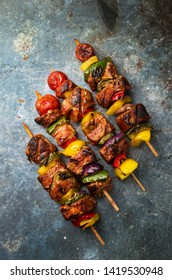 Grilled Shish kebab with vegetables on the table