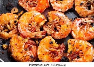 Grilled shrimp with garlic, pink orange shrimp, seafood backdrop background