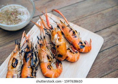 Grilled shrimp (Giant freshwater prawn) grilling with charcoal premium grade display for sale at Thai street food market or restaurant in Bangkok Thailand